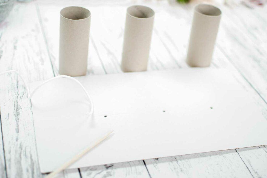 drei Papprollen für Kerzen gießen